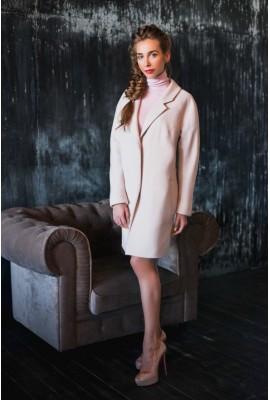 Пальто рожевого кольору